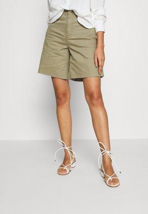 MEJA DENIM SHORTS - Denim shorts - green agate