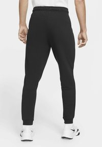 Nike Performance - PANT TAPER - Tracksuit bottoms - black/white - 1