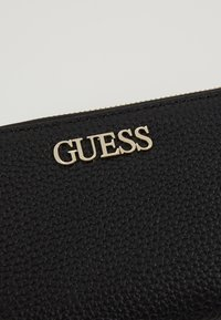 Guess - ALBY SLG LARGE ZIP AROUND - Wallet - black - 2