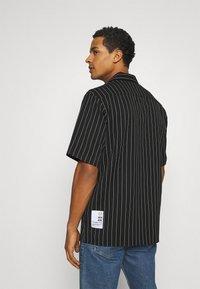 Blood Brother - ASHLAND BOXY UNISEX - Button-down blouse - black - 2