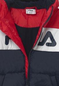 Fila - LYNN PUFF UNISEX - Winter jacket - black iris/true red/bright white - 2