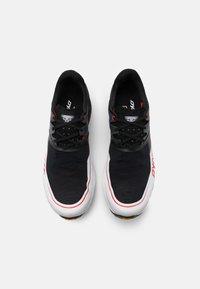 Dynafit - ALPINE DNA - Trail running shoes - black out/orange - 3