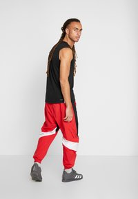 adidas Performance - SHAPE PANT - Tracksuit bottoms - scarlet - 2
