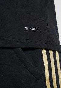 adidas Performance - REAL MADRID TEE - Club wear - black/gold - 6