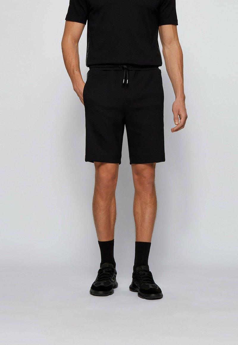 BOSS - HEADLO  - Tracksuit bottoms - black