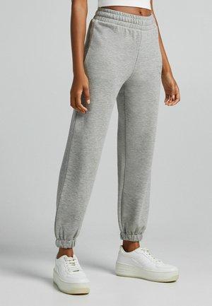 PLÜSCH - Tracksuit bottoms - grey