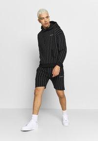 Good For Nothing - GOOD FOR NOTHING OVERSIZED HOODIE - Bluza z kapturem - black - 1