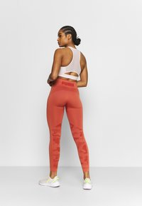 Puma - EVOKNIT SEAMLESS LEGGINGS - Medias - autumn glaze - 2