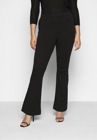Vero Moda Curve - VMKAMMA FLARED PANT - Bukse - black - 0