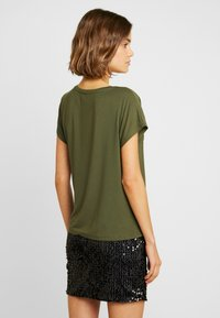 ONLY - ONLLOUISA SEQUINS - Blouse - kalamata