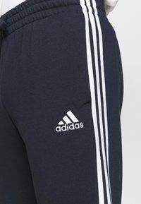adidas Performance - 3 STRIPES  ESSENTIALS - Tracksuit bottoms - legend ink/white - 4