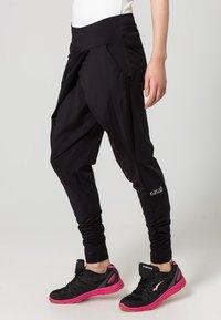 Casall - FLOW - Pantalones deportivos - black - 2