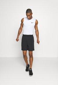Nike Performance - M NP TOP SL TIGHT - Sports shirt - white - 1