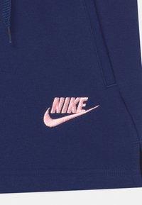 Nike Sportswear - CLUB - Tracksuit bottoms - blue void - 2