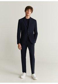 Mango - TRAVEL - Suit trousers - dunkles marineblau - 1