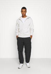 Nike Sportswear - CLUB HOODIE - Zip-up hoodie - light bone/white - 1