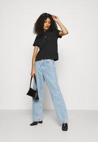 Calvin Klein Jeans - ARCHIVES TEE - Printtipaita - black - 1