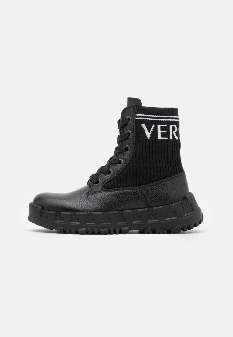 Versace - LOGATA - Lace-up ankle boots - black