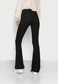 ONLY Tall - ONLNELLA FLARED PANT - Pantaloni - black - 2