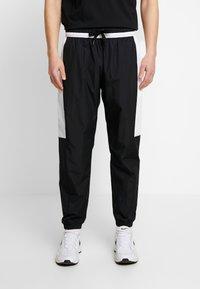 Nike Sportswear - AIR - Verryttelyhousut - black/white - 0