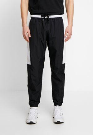 AIR - Tracksuit bottoms - black/white