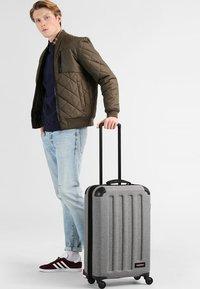 Eastpak - TRANZSHELL - Wheeled suitcase - sunday grey - 0