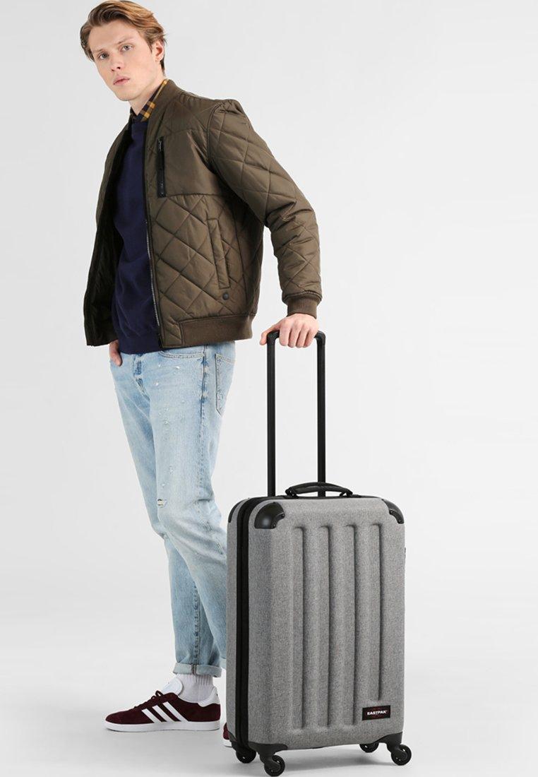 Eastpak - TRANZSHELL - Wheeled suitcase - sunday grey