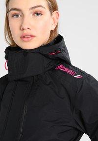 Superdry - TECH HOOD POP ZIP WINDCHEATER - Summer jacket - black/raspberry - 3