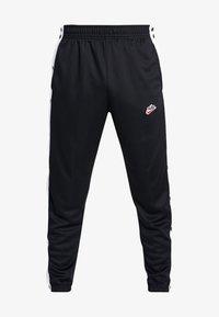 Nike Sportswear - TEARAWAY  - Tracksuit bottoms - black/white - 4