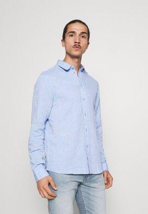 Camisa - mottled blue