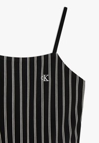 Calvin Klein Jeans - CITY STRIPE STRAP - Jumpsuit - black - 3