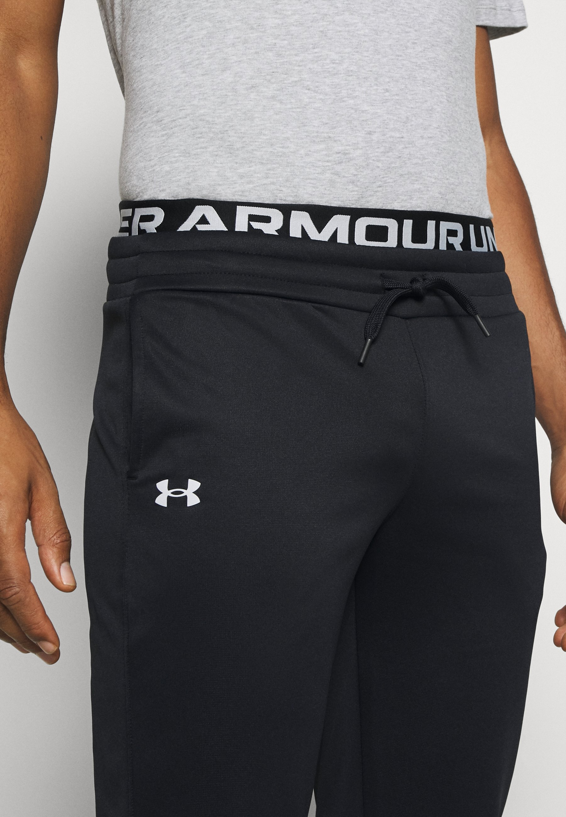 Under Armour BRANDED PANTS - Tracksuit bottoms - black n5y16