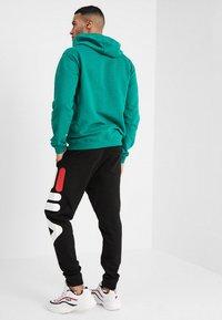 Fila - PURE - Pantaloni sportivi - black - 2