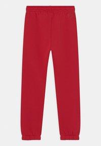 Jordan - JUMPMAN PANTS UNISEX - Teplákové kalhoty - gym red - 1