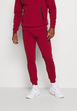 OSTERIA - Tracksuit bottoms - dark red