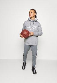 Jordan - AIR DRY PANT - Pantaloni sportivi - carbon heather/black - 1
