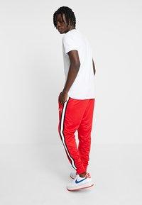 Nike Sportswear - Tracksuit bottoms - university red - 2