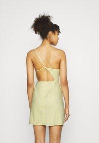 NA-KD - MINI DRESS - Cocktail dress / Party dress - dusty yellow - 2