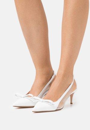 Classic heels - latte/trasparente
