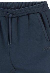 BOSS - HADIKO - Pantaloni sportivi - dark blue - 5