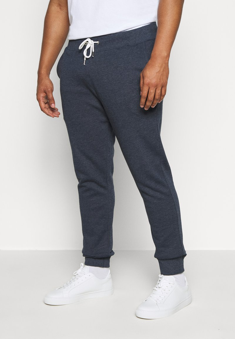 Pier One - Tracksuit bottoms - mottled dark blue
