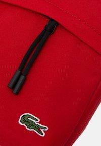 Lacoste - Camera bag - haut rouge - 3