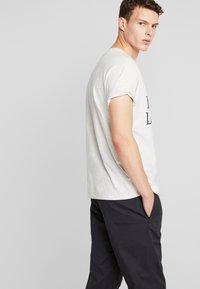 New Balance - ATHLETICS PANT - Trousers - black - 2