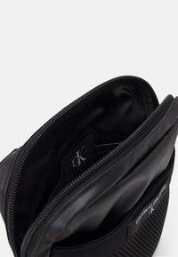 Calvin Klein Jeans - MINI REPORTER - Taška spříčným popruhem - black - 2
