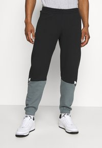 adidas Originals - SLICE - Tracksuit bottoms - black/blue oxide - 0