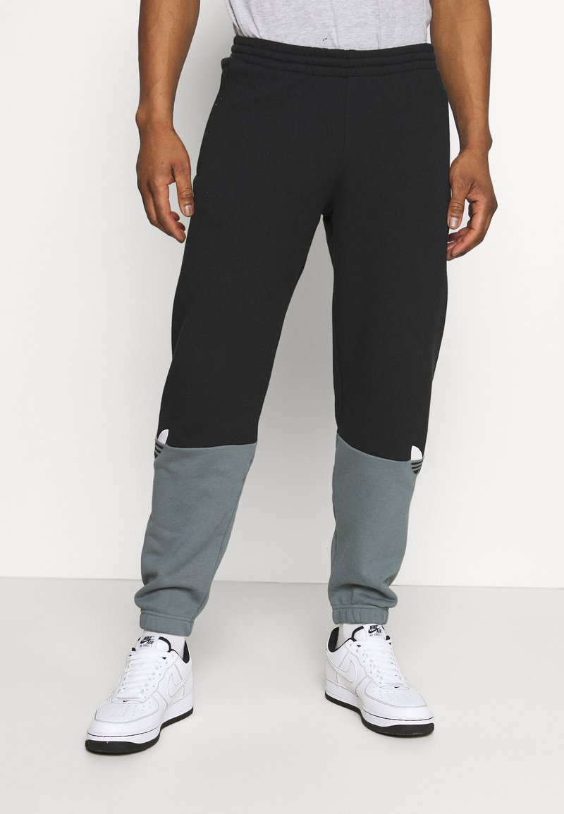 adidas Originals - SLICE - Tracksuit bottoms - black/blue oxide