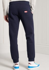 Superdry - Tracksuit bottoms - nautical navy - 1