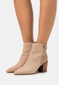 ALDO - JANEECE FLEX - Ankle boots - beige - 0