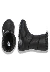 The North Face - M NUPTSE BOOTIE 700 - Winter boots - tnf black/tnf white - 1