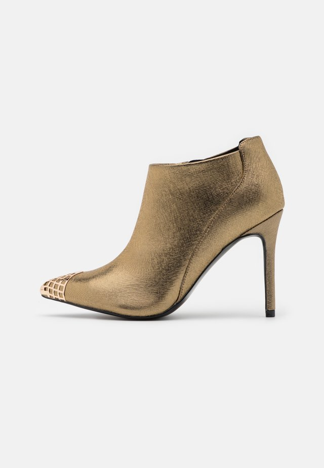PUNK - High heeled ankle boots - gold